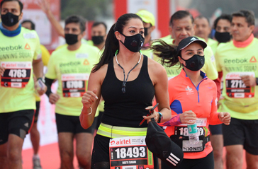 'My eyes are burning': Delhi holds half marathon